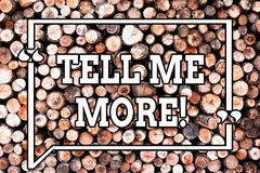 Text sign showing Tell Me More. Conceptual photo A call to start a conversation Sharing more knowledge Wooden background. Vintage wood wild message ideas royalty free illustration