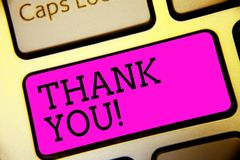 Text sign showing Thank You. Conceptual photo replaying on something good or greetings with pleased way Keyboard purple key Intent. Ion create computer computing stock photos