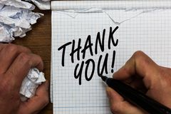 Text sign showing Thank You. Conceptual photo replaying on something good or greetings with pleased way Man holding marker noteboo. K crumpled papers ripped royalty free stock photos