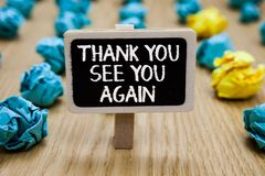 Text sign showing Thank You See You Again. Conceptual photo Appreciation Gratitude Thanks I will be back soon Paperclip. Hold written chalkboard behind paper royalty free stock images