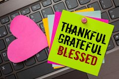 Text sign showing Thankful Grateful Blessed. Conceptual photo Appreciation gratitude good mood attitude Bright colorful written pa. Pers pinch by pin pink heart royalty free stock photography