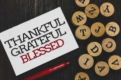 Text sign showing Thankful Grateful Blessed. Conceptual photo Appreciation gratitude good mood attitude Written paper red marker b. Eside round woody alphabets royalty free stock image