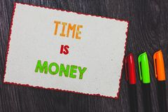 Text sign showing Time Is Money. Conceptual photo Better to do things as quickly as possible Do not delay White paper red borders. Colorful markers wooden stock image