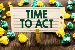 Text sign showing Time To Act. Conceptual photo Do it now Response Immediately Something need to be done Clothespin holding notebo. Ok paper crumpled papers stock photography