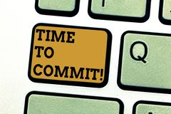 Text sign showing Time To Commit. Conceptual photo Engagement or obligation that restricts freedom of action Keyboard. Key Intention to create computer message stock photography