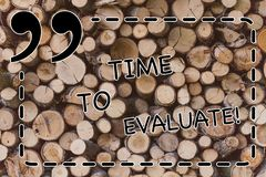 Text sign showing Time To Evaluate. Conceptual photo Moment rate used before products or service Give feedback Wooden. Text sign showing Time To Evaluate stock photos