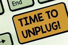 Text sign showing Time To Unplug. Conceptual photo Relaxing giving up work disconnecting from everything Keyboard key. Intention to create computer message stock photography