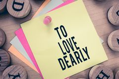 Text sign showing To Love Dearly. Conceptual photo Love someone very much in the more humble way and aimlessly.  Royalty Free Stock Photos