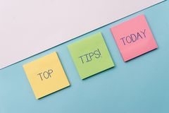 Text sign showing Top Tips. Conceptual photo small but particularly useful piece of practical advice Pastel colour note stock image