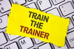 Text sign showing Train The Trainer. Conceptual photo Learning Technique Students being teachers themselves written on Tear Sticky. Text sign showing Train The royalty free stock photo
