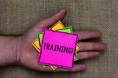 Text sign showing Training Motivational Call. Conceptual photo Organized activity to develop skill set of people Holding small pit. Ches art papers thoughts stock photo