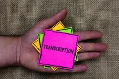 Text sign showing Transcription. Conceptual photo Written or printed process of transcribing words text voice Holding small pitche. S art papers thoughts ideas stock image