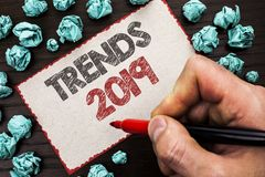 Text sign showing Trends 2019. Conceptual photo Current Movement Latest Branding New Concept Prediction written by Man Holding Mar. Ker Cardboard Piece the stock photo