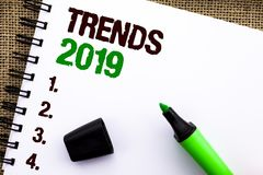 Text sign showing Trends 2019. Conceptual photo Current Movement Latest Branding New Concept Prediction written on Notebook Book o. Text sign showing Trends 2019 stock images