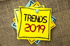 Text sign showing Trends 2019. Conceptual photo Current Movement Latest Branding New Concept Prediction written on Sticky Note Pap. Text sign showing Trends 2019 stock image