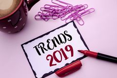 Text sign showing Trends 2019. Conceptual photo Current Movement Latest Branding New Concept Prediction written on Sticky Note Pap. Text sign showing Trends 2019 royalty free stock photos