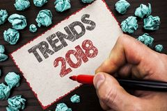 Text sign showing Trends 2018. Conceptual photo Current Movement Latest Modern Branding New Concept Prediction written by Man Hold. Ing Marker Cardboard Piece stock photography