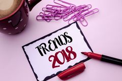 Text sign showing Trends 2018. Conceptual photo Current Movement Latest Modern Branding New Concept Prediction written on Sticky N. Text sign showing Trends 2018 royalty free stock photos