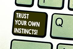Text sign showing Trust Your Own Instincts. Conceptual photo Intuitive follow demonstratingal feelings confidence. Keyboard key Intention to create computer stock image