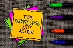 Text sign showing Turn Knowledge Into Action. Conceptual photo Apply what you have learned Leadership strategies Written on some c. Olorful sticky note 4 pens royalty free stock photos