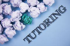 Text sign showing Tutoring. Conceptual photo Mentoring Teaching Instructing Preparing Supporting Give lessons written on the Plain. Text sign showing Tutoring Stock Photo