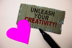 Text sign showing Unleash Your Creativity Call. Conceptual photo Develop Personal Intelligence Wittiness Wisdom Brown paperboard r. Ough ideas message heart wild stock images
