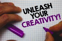 Text sign showing Unleash Your Creativity Call. Conceptual photo Develop Personal Intelligence Wittiness Wisdom Man hold holding p. Urple marker notebook page royalty free stock photos