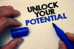 Text sign showing Unlock Your Potential. Conceptual photo access your true skills and powers Believe in yourself Graph paper grey. Important thoughts ideas royalty free stock images