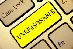 Text sign showing Unreasonable. Conceptual photo Beyond the limits of acceptability or fairness Inappropriate Keyboard yellow key. Intention create computer royalty free stock image