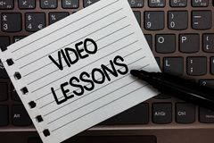 Text sign showing Video Lessons. Conceptual photo Online Education material for a topic Viewing and learning Notebook piece paper. Keyboard Inspiration ideas royalty free stock image