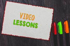Text sign showing Video Lessons. Conceptual photo Online Education material for a topic Viewing and learning White paper red borde. Rs colorful markers wooden stock photos