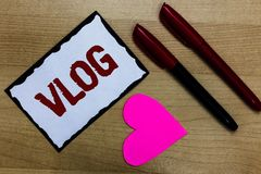 Text sign showing Vlog. Conceptual photo Entertaining multimedia self broadcasting news reporting stories Love pure wood colour ha. Rt marker pens art work black Stock Image