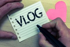 Text sign showing Vlog. Conceptual photo Entertaining multimedia self broadcasting news reporting stories Wood nice love colour ha. Rt marker pen art work Royalty Free Stock Photos