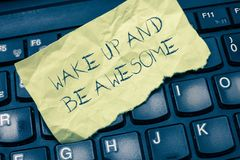 Text sign showing Wake Up And Be Awesome. Conceptual photo Rise up and Shine Start the day Right and Bright.  stock photography
