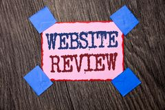 Text sign showing Website Review. Conceptual photo Homepage Evaluation Customer Opinion Satisfaction Ranking written on Pink Stick. Text sign showing Website royalty free stock photography