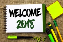 Text sign showing Welcome 2018. Conceptual photo Celebration New Celebrate Future Wishes Gratifying Wish written on Notebook Book Stock Photography