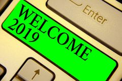Text sign showing Welcome 2019. Conceptual photo New Year Celebration Motivation to Start Cheers Congratulations Keyboard green ke. Y Intention create computer royalty free stock photography