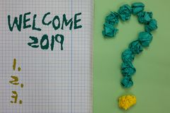 Text sign showing Welcome 2019. Conceptual photo New Year Celebration Motivation to Start Cheers Congratulations Notebook paper cr. Umpled papers forming royalty free stock photo