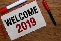 Text sign showing Welcome 2019. Conceptual photo New Year Celebration Motivation to Start Cheers Congratulations White paper red b. Orders markers wooden royalty free stock photos