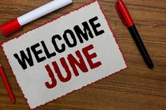 Text sign showing Welcome June. Conceptual photo Calendar Sixth Month Second Quarter Thirty days Greetings White paper red borders. Markers wooden background stock photos