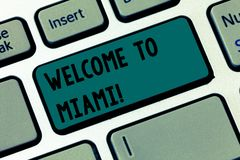 Text sign showing Welcome To Miami. Conceptual photo Arriving to Florida sunny city summer beach vacation Keyboard key royalty free stock images