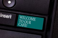 Text sign showing Welcome To Our Cafe. Conceptual photo Greeting receiving showing in restaurant good attention Keyboard stock images