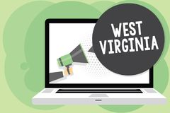 Text sign showing West Virginia. Conceptual photo United States of America State Travel Tourism Trip Historical Man holding Megaph. One loudspeaker computer Stock Photo