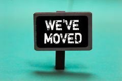 Text sign showing Weve have Moved. Conceptual photo going to live from place another same or different country Blackboard green ba. Ckground important message royalty free stock image