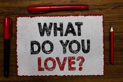 Text sign showing What Do You Love question. Conceptual photo Enjoyable things passion for something inspiration Red bordered whit. E page centered some texts royalty free stock photos