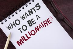 Text sign showing who Wants To Be A Millionaire Question. Conceptual photo Earn more money applying knowledge written on Notepad o. Text sign showing who Wants Royalty Free Stock Images