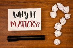 Text sign showing Why It Matters Question. Conceptual photo Important Reasons to do something Motivation Goal Ideas on paper woode. N background quotation mark Stock Photography