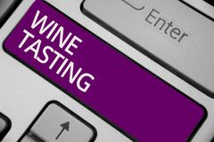 Text sign showing Wine Tasting. Conceptual photo Degustation Alcohol Social gathering Gourmet Winery Drinking Keyboard purple key royalty free stock images