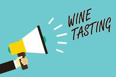 Text sign showing Wine Tasting. Conceptual photo Degustation Alcohol Social gathering Gourmet Winery Drinking Man holding megaphon. E loudspeaker blue background royalty free stock images