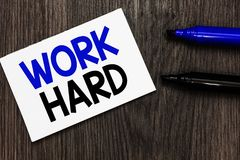 Text sign showing Work Hard. Conceptual photo Laboring that puts effort into doing and completing tasks Important idea ideas noteb. Ook marker markers wooden stock image